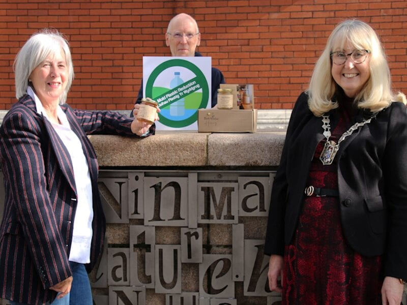 Honey handover: MPR newsletter prize winner Susan Broadaway with Mayor of Mold Teresa Carberry and newsletter editor Eric Davies pictured in Daniel Owen Square