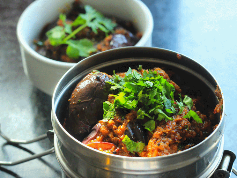Tiffin tins with aubergine curry.