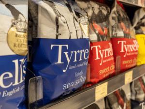 Crisp packets on supermarket shelf