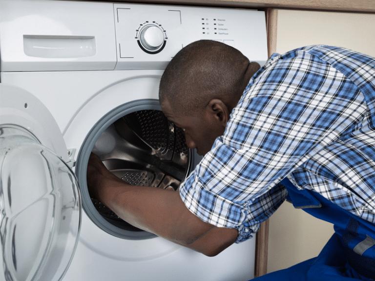 Man repairing washing machine