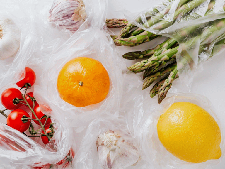 Stylised image of fruit and vegetables wrapped in transparent plastic.