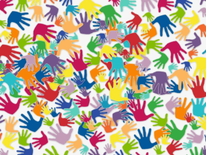 Lots of brightly coloured hands on white background.