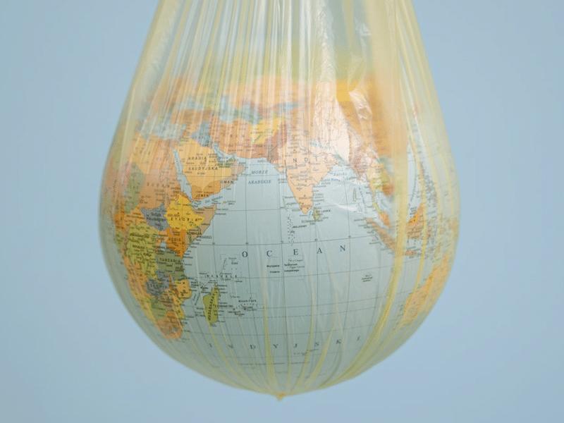 Globe shrouded in platic bag