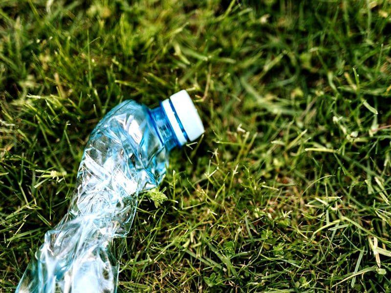 crushed-plastic-bottle-on-green-park-grass-4498090